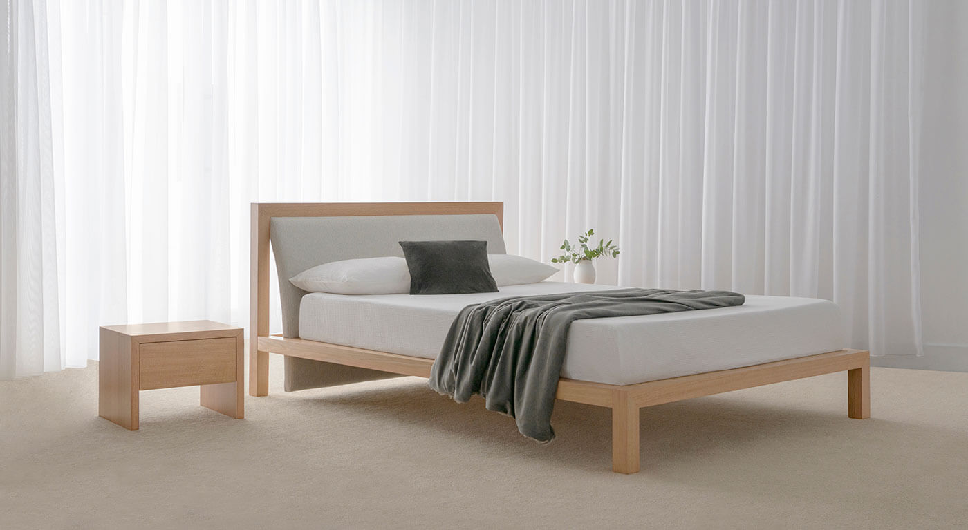designer bedroom furniture crafted from hardwood timber and fabric upholstered headboard