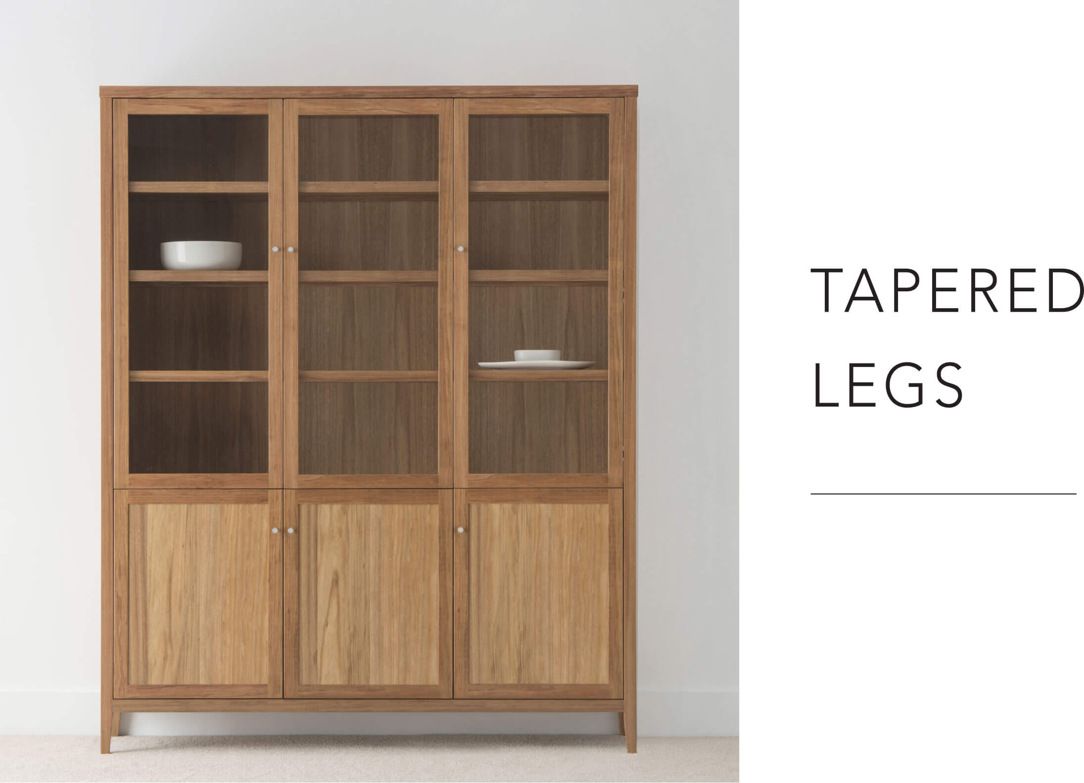 contemporary timber wall unit with glass doors and hidden shelving