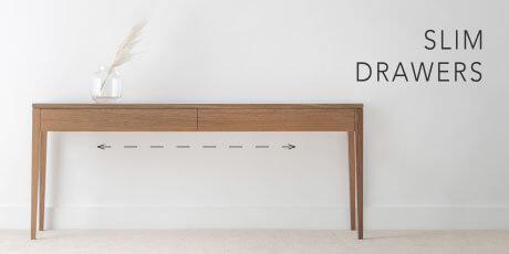 contemporary hall table with tapered legs and slim storage drawers