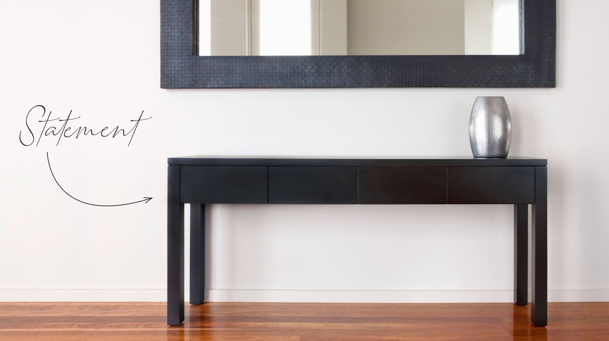 statement hallway table in black finish with drawers and mirror decoration