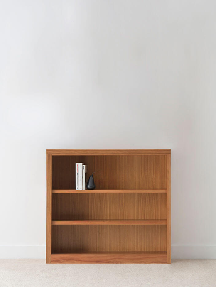 small timber bookcase with square corners and two shelves for home office storage