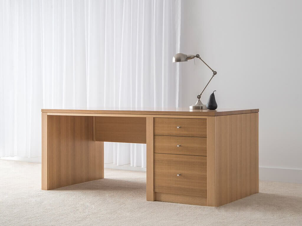 executive desk in mountain ash, with 2 small drawers and 1 filing drawer with solid timber side panels