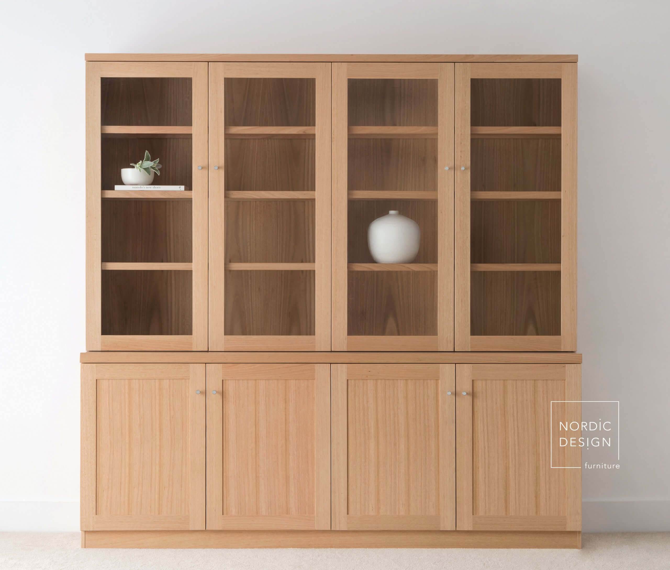 large wall cabinet with doors and internal shelving