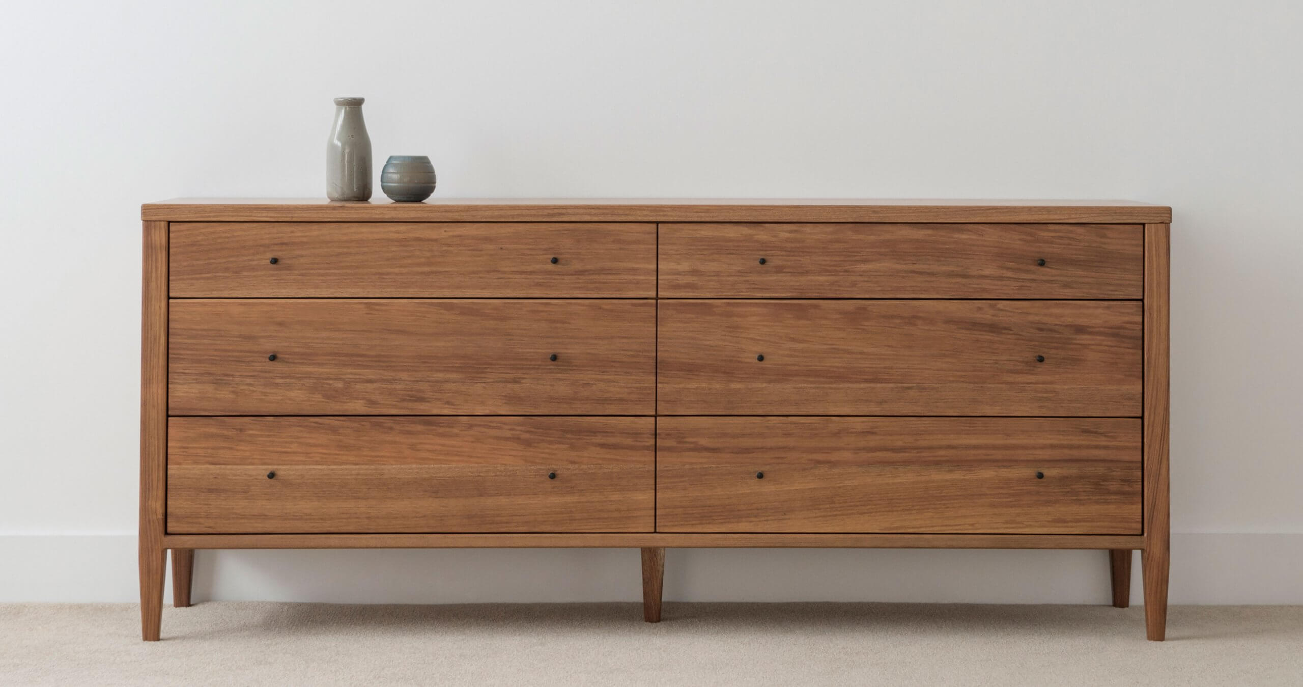 chest of drawers made from solid timber with 6 drawers and tapered legs