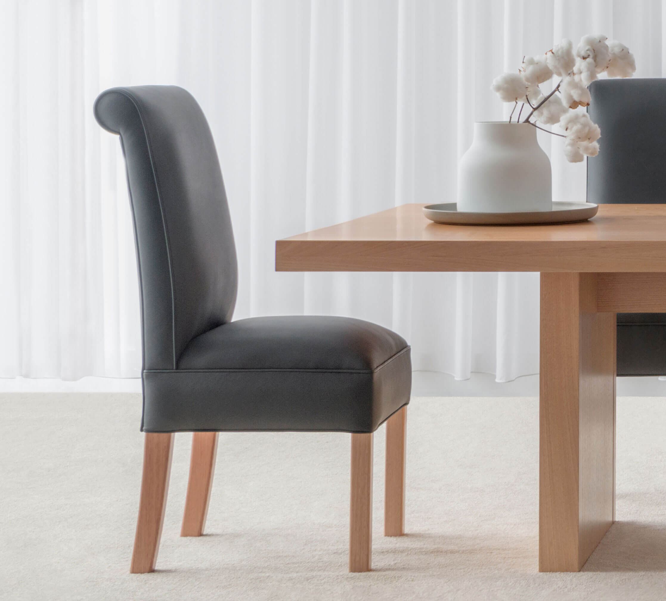 high back leather dining chair with feature head roll