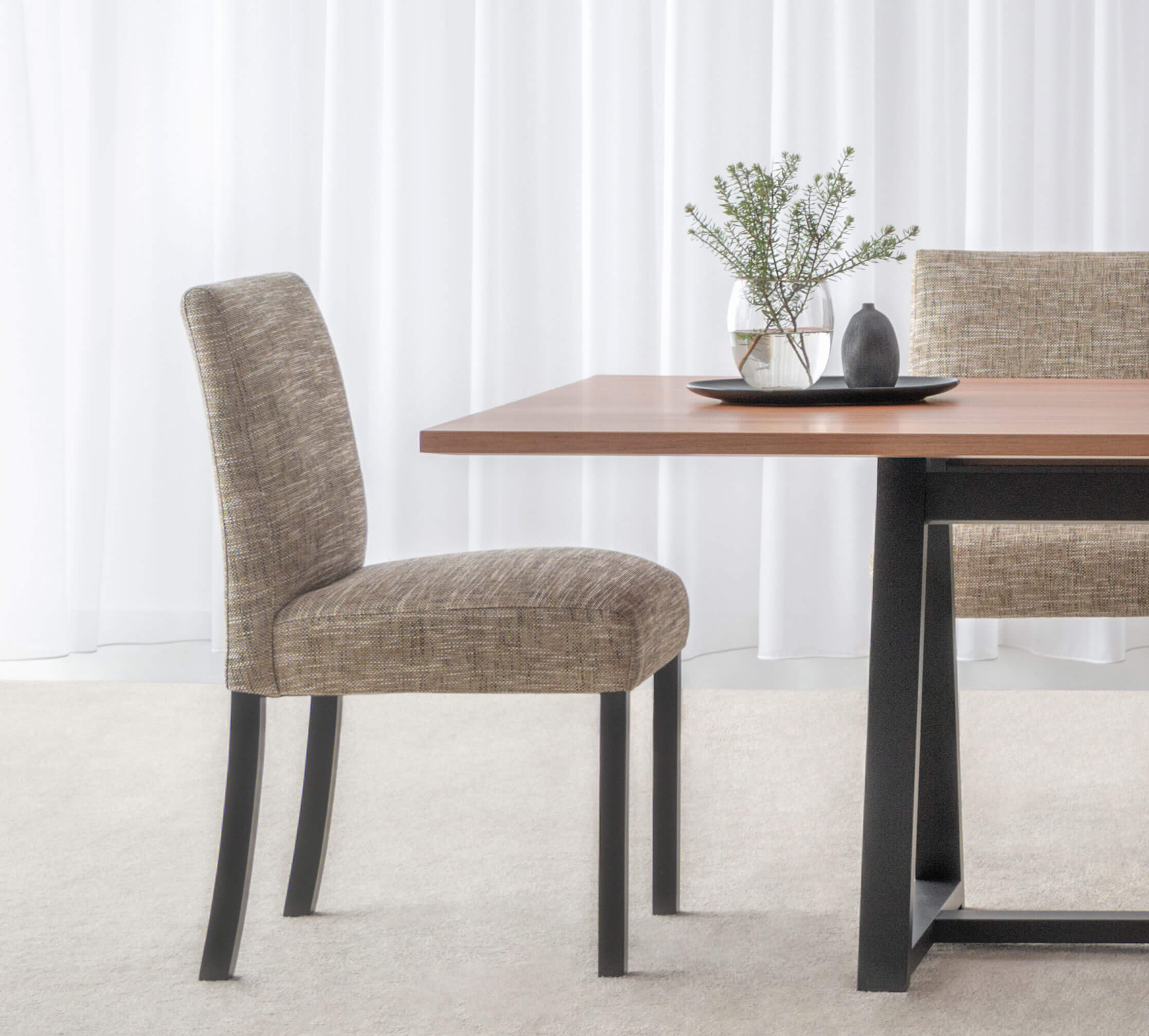 comfortable fabric dining chair with black timber legs