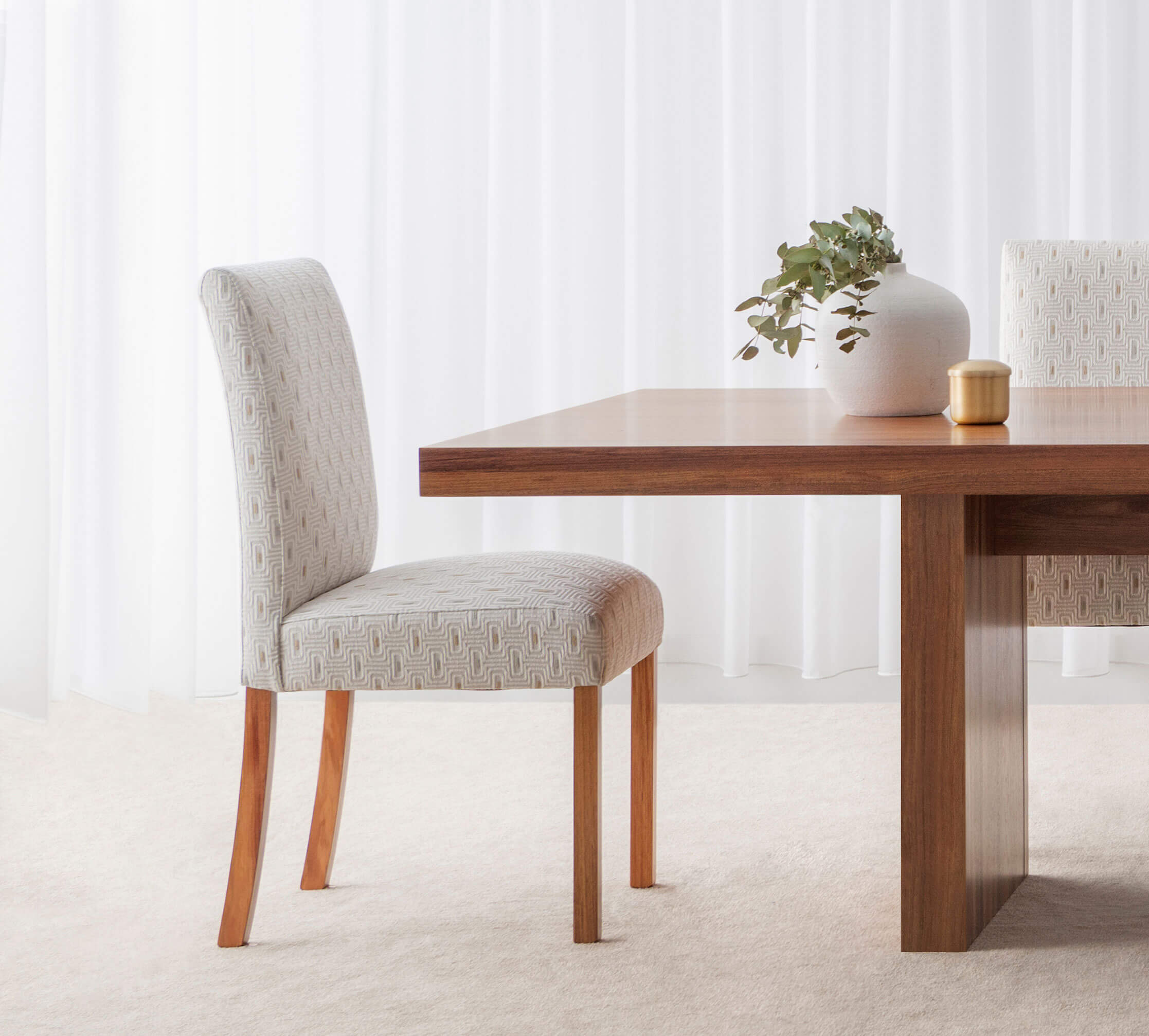 high back upholstered dining chair in light fabric