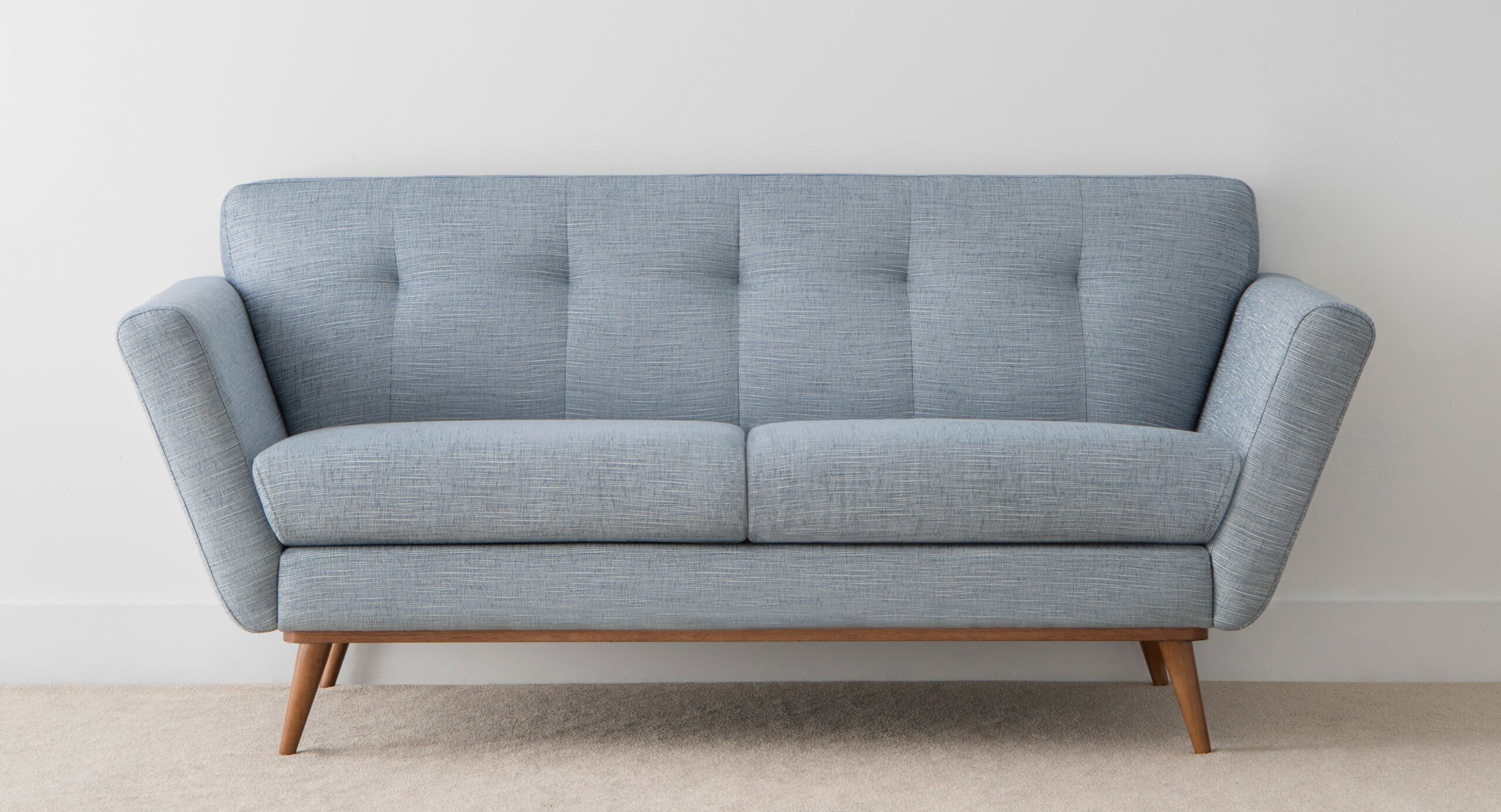 Blue Fabric Sofa with pinched back and rounded timber legs