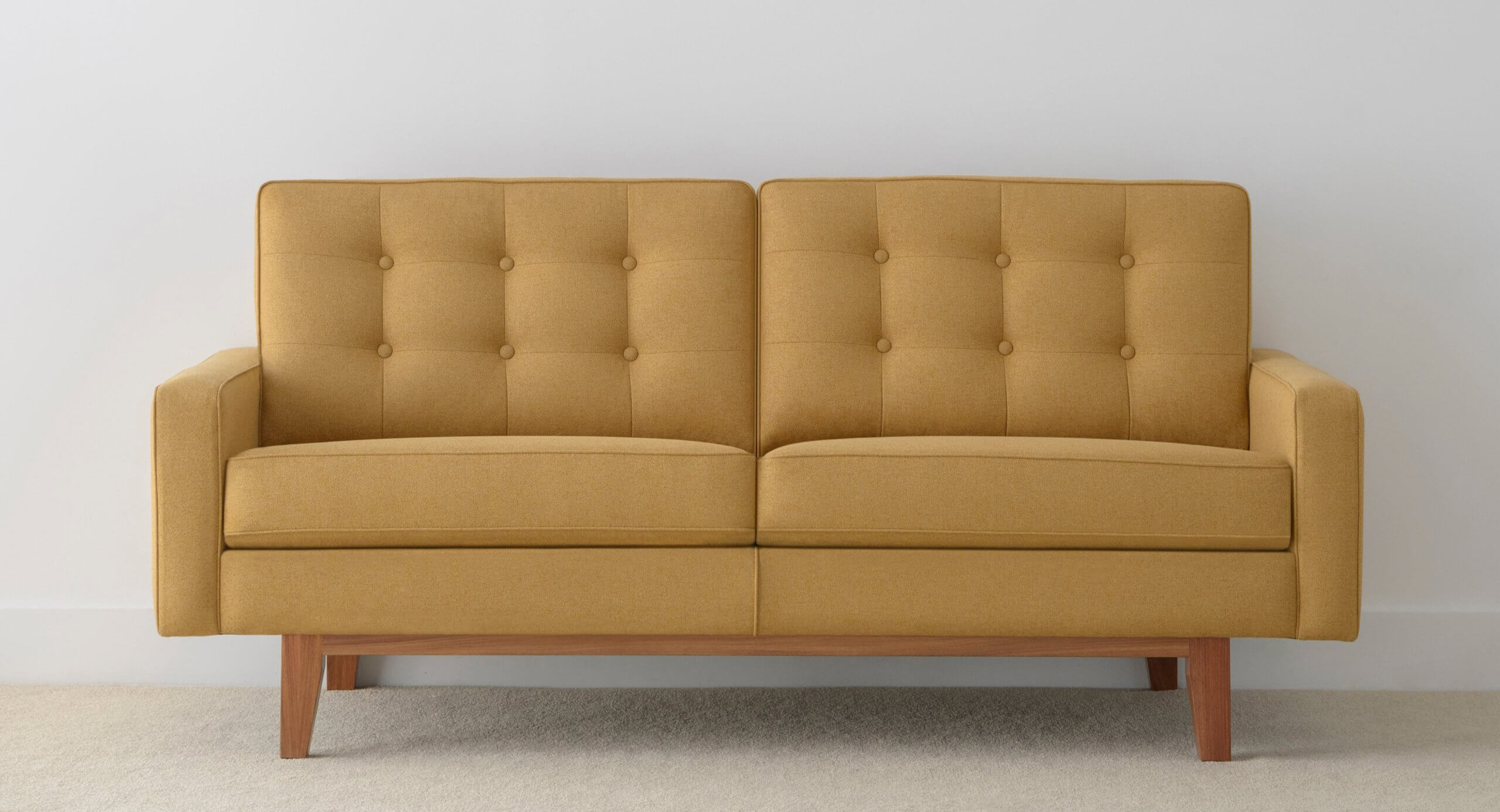 Fabric Sofa with button back detail and timber base