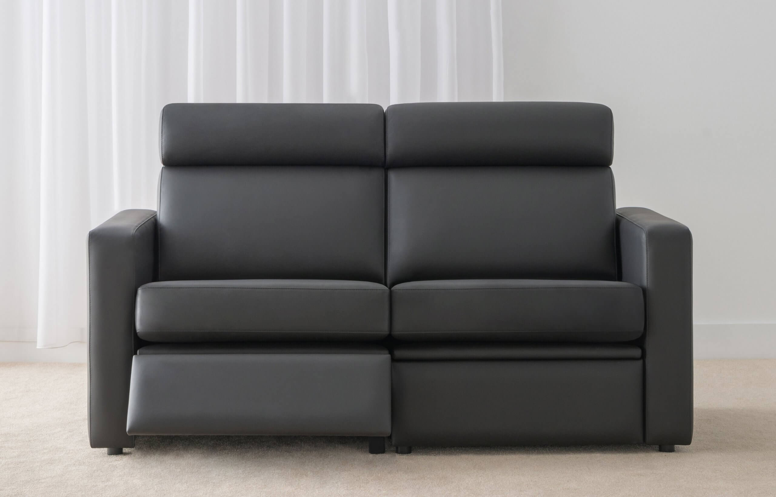 black leather lounge suite with recliner option
