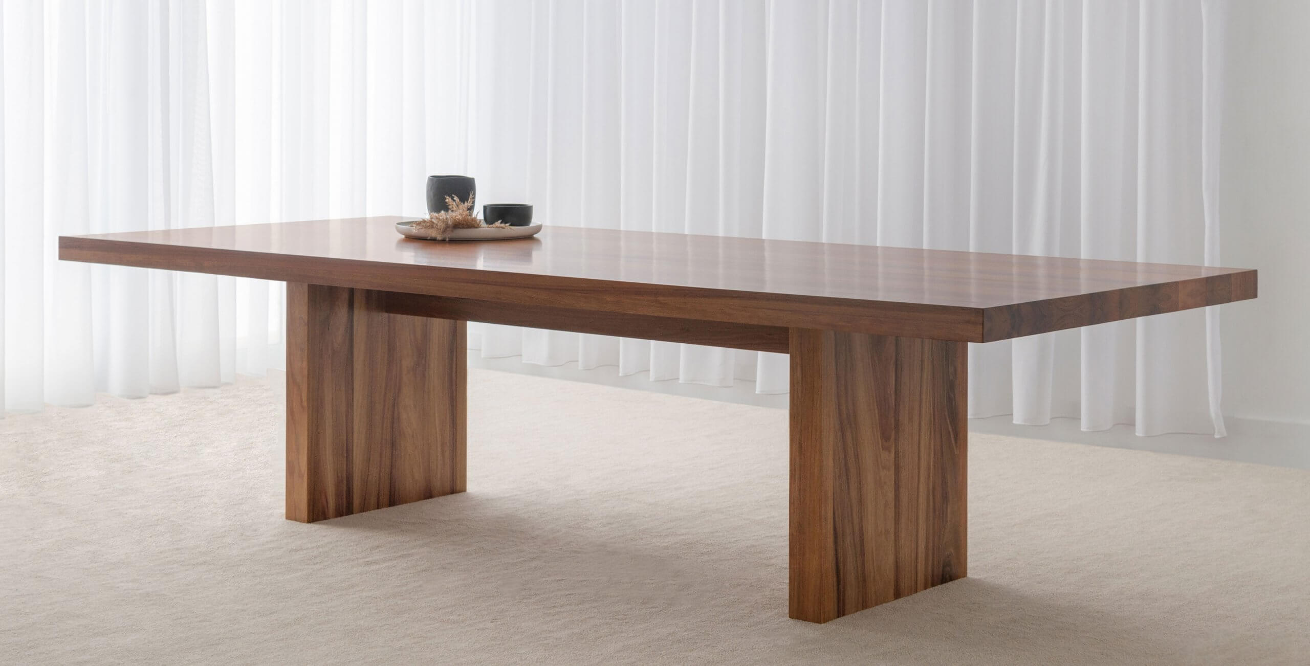 large rectangular dining table made from solid blackwood timber